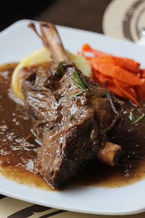 roast lamb: close up Braised lamb shank in mint and rosemary gravy Stock Photo