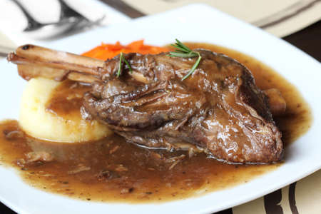 rack of lamb: close up Braised lamb shank in mint and rosemary gravy Stock Photo