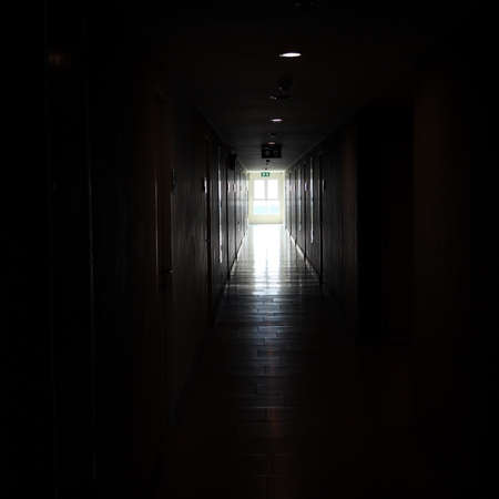 light from window in black dark building walkway photo