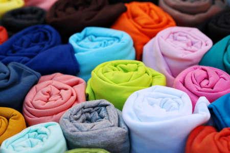 colorful t shirt backgorund, fabric roll Standard-Bild