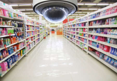 inside technology: CCTV and blurred supermarket background Stock Photo
