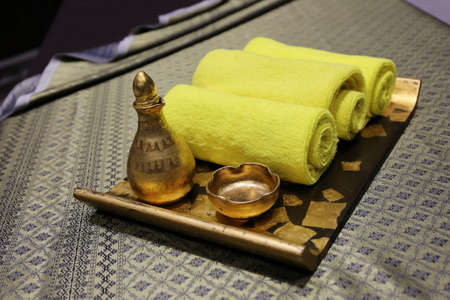 natural soap: Spa and wellness setting with natural soap, candles and towel