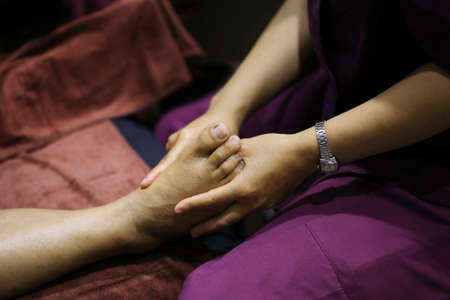 traditional healer: women hand foot massage in spa