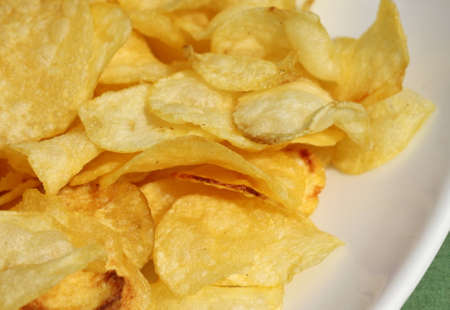 unhealthful: fried potato chip, closeup