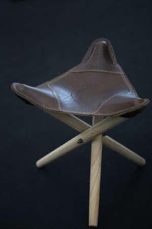 portative: three legs leather chair