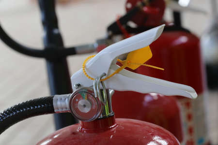 fire hazard: closeup of Fire extinguisher lever