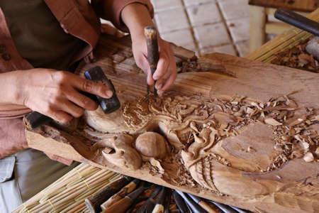 mastery: craftsman carving wood, thai art Stock Photo