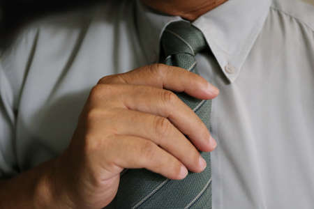 hand with necktie of businessman Stock Photo