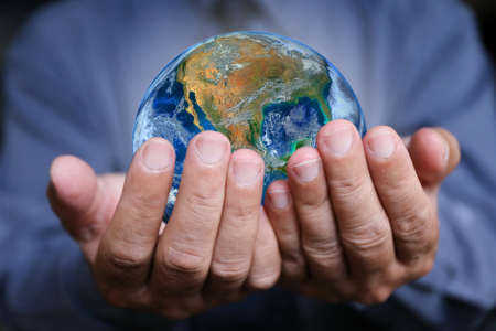 climate change: businessman with the earth