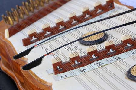 instrumentalist: dulcimer, asian musical instrument