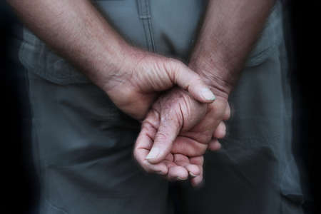 ceasefire: blurred soldier hand, background Stock Photo