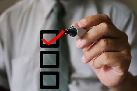 businessman hand with pen check correct Standard-Bild