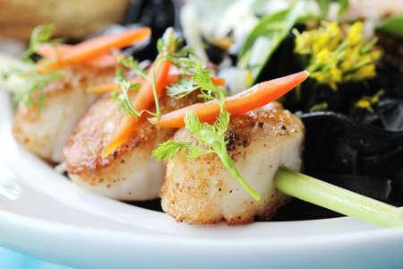 seared: closeup of seared scallops on plate