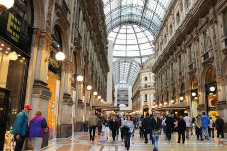 vittorio emanuele: MILAN, ITALY - JULY 9, 2014: Prada Store in Galleria Vittorio Emanuele II shopping mall in Milan, with shoppers and tourists strolling around. Prada is an Italian luxury fashion house founded in 1913