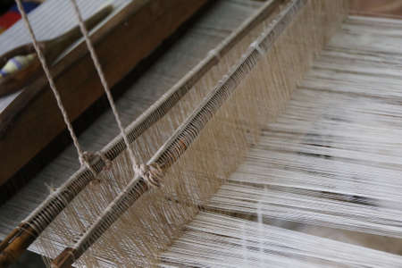 loom: cotton on the loom background Stock Photo