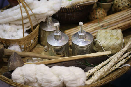 wick: small torch and metal bottle with cotton wick, Chiang Mai, Thailand