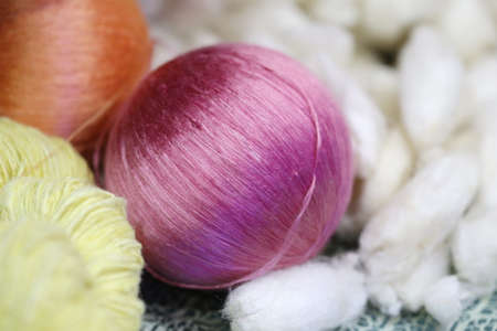 weave ball: colorful raw silk thread in basket Stock Photo