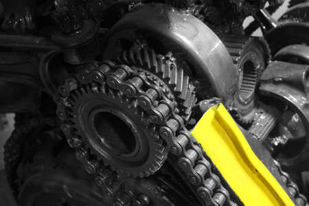 serrate: old gear and chain, machinery part background