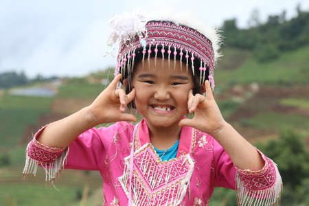 unicef: CHIANG MAI, THAILAND - OCTOBER 25 : Portrait of unidentified Akha hill tribe children with traditional at Wat Phratat Doi Suthep on OCTOBER 25, 2014 in Chiang Mai, Thailand. Editoriali