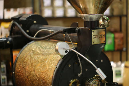 gold shovel: classic coffee bean roast machine Stock Photo