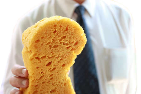 household tasks: businessman with yellow sponge Stock Photo