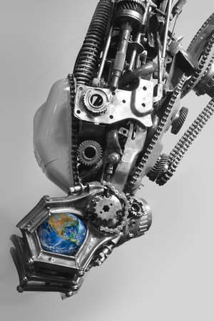 cyber war: the earth in robot hand Stock Photo