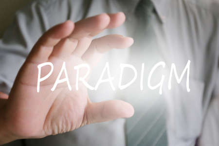 paradigm: businessman hand, paradigm text