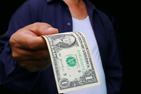 show bill: Businessman giving money, united states dollar (USD) bills - cash
