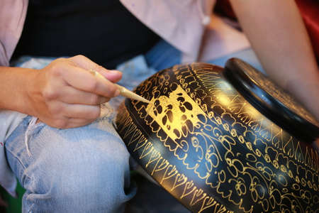 lacquerware: hand paint gold color on bowl, Thailand hand craft Stock Photo