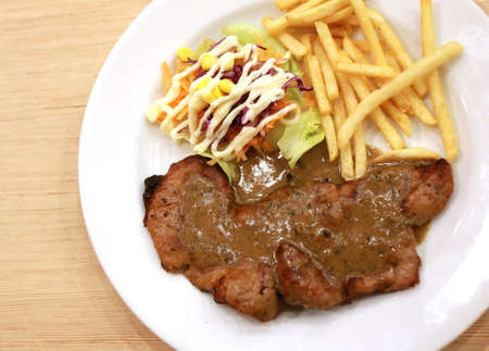 stake: pork stake with french fried on plate