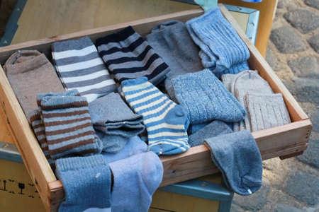 many blue sock in wood tray Standard-Bild
