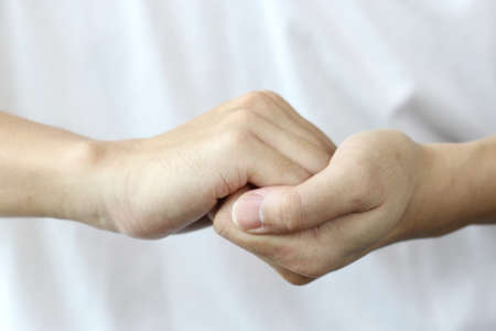 trustful: two man hand hold, help
