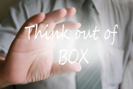 think out of the box: businessman hand, think out of box text