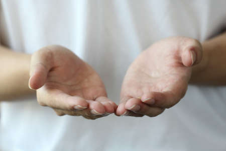 two persons only: reaching cupped hands Stock Photo
