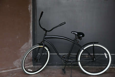 dutch girl: classic bicycle stand near wall