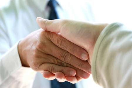 new generation: businessman handshake with young man for start up new generation business