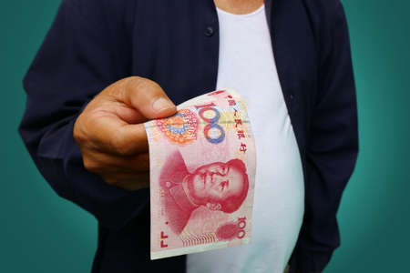 show bill: businessman holding yuan RMB in his hands