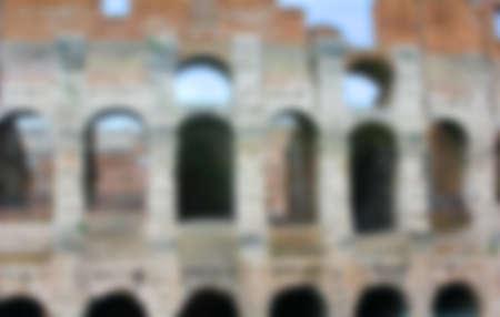 amphitheatre: blurred Colosseum, Flavian Amphitheatre in Rome, Italy, background