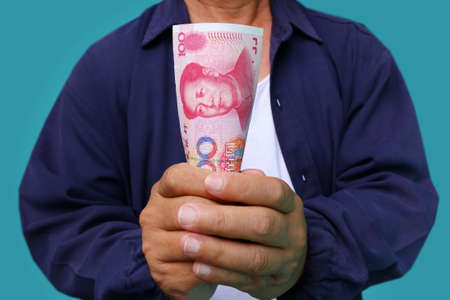 yuan: businessman holding yuan RMB in his hands