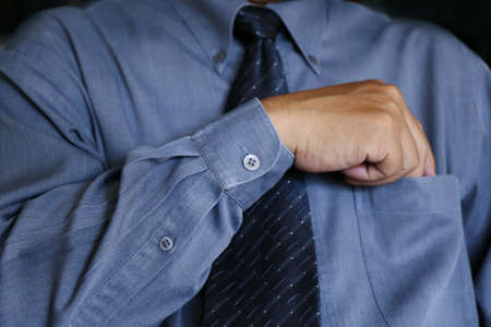 hand in pocket: man hand pick something in shirt pocket Stock Photo