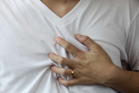 heartbreak issues: hand hold on chest, heart attack sign