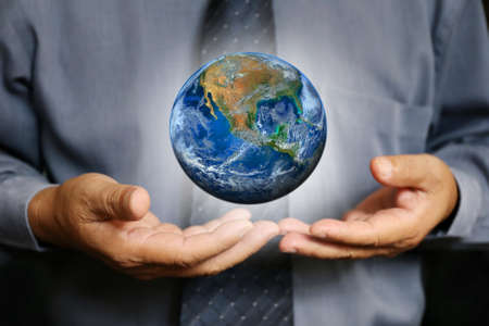 businessman carrying a globe: businessman hand hold the earth , politics or environmental conservation Earth