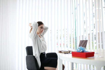 Smart Businesswoman handshake for closing the deal with business people team happy good success result in office concept background. Gift new year red box to staff. Stock Photo