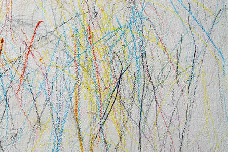 Drawing with colored pencil on the wall of a child. Stock Photo