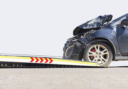 accident Car Slide on truck for move. Black car have damage by accident on road take with slide truck move . Isolate on white background.