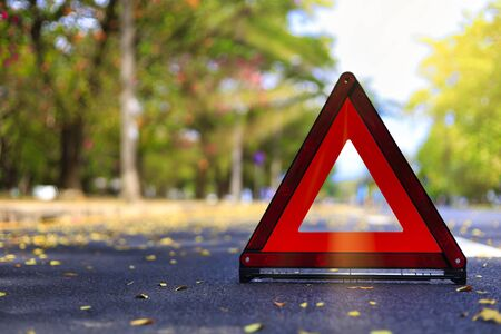 Red triangle, red emergency stop sign, red emergency symbol on road. With copy space for text or design