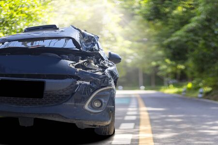 Front of blue color car with pick up have big damaged and broken by accident on road in morning time can not drive any more park for wait insurance officer. With copy space for text or design Stok Fotoğraf
