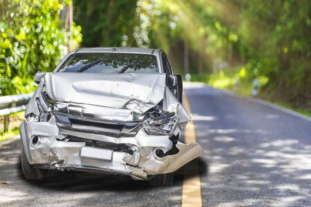 Front of light gray color car with pick up have big damaged and broken by accident on road in morning time can not drive any more park for wait insurance officer. With copy space for text or design Stok Fotoğraf