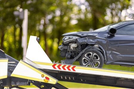 accident Car Slide on truck for move. Black car have damage by accident on road take with slide truck move .