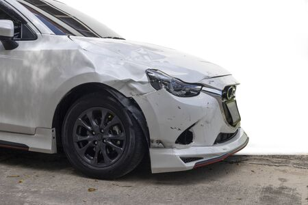 Front of white color car damaged and broken by accident isolated on white background. Imagens